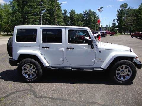 2012 Jeep Wrangler Unlimited for sale at G and G AUTO SALES in Merrill WI