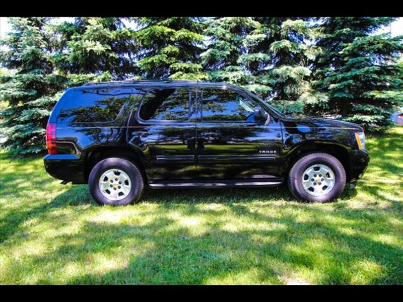 2013 Chevrolet Tahoe for sale at HUFF AUTO GROUP in Jackson MI