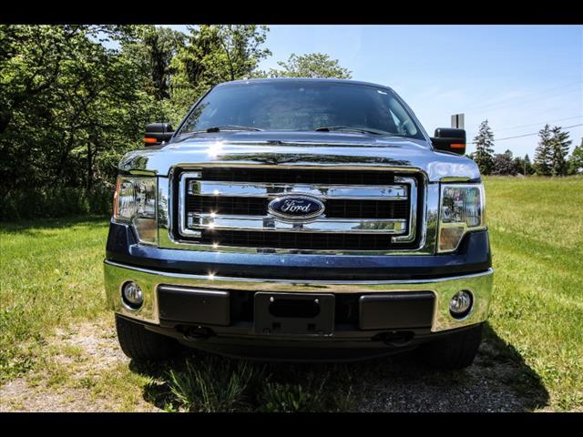 2013 Ford F-150 for sale at HUFF AUTO GROUP in Jackson MI