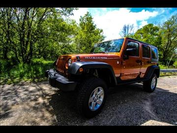 2010 Jeep Wrangler Unlimited for sale at HUFF AUTO GROUP in Jackson MI