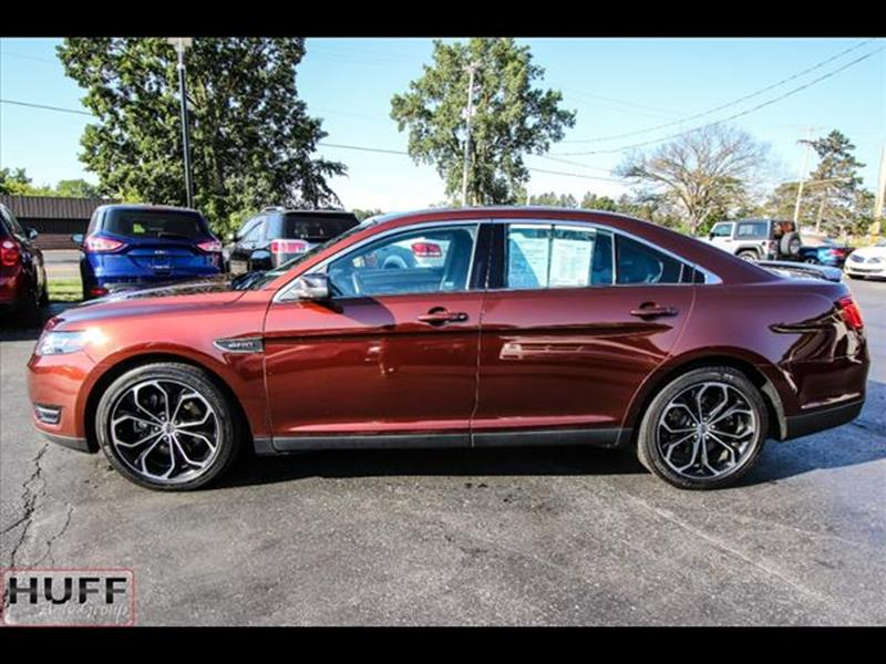 2015 Ford Taurus for sale at HUFF AUTO GROUP in Jackson MI