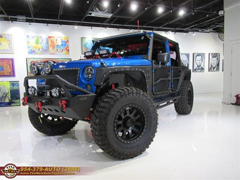 2015 Jeep Wrangler Unlimited for sale at The New Auto Toy Store in Fort Lauderdale FL