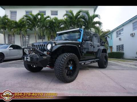 2013 Jeep Wrangler Unlimited for sale at The New Auto Toy Store in Fort Lauderdale FL