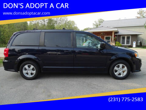 2011 Dodge Grand Caravan for sale at DON'S ADOPT A CAR in Cadillac MI