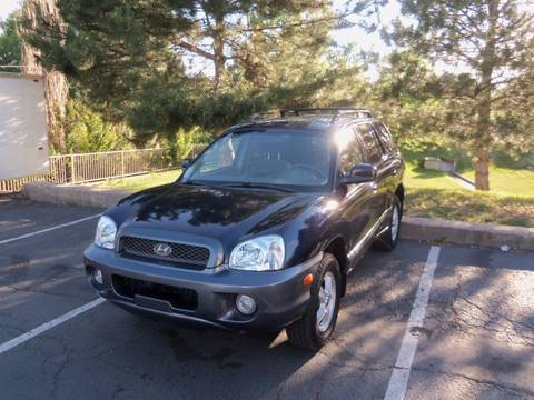 2004 Hyundai Santa Fe for sale at QUEST MOTORS in Englewood CO