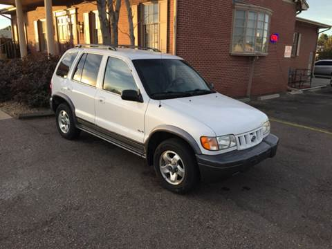 2002 Kia Sportage for sale at QUEST MOTORS in Englewood CO