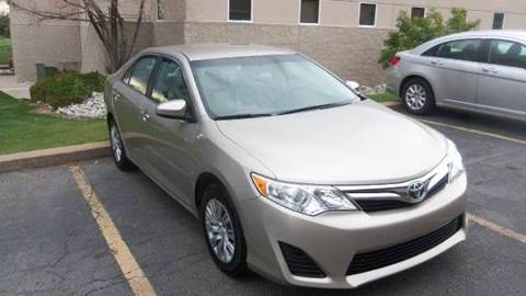 2014 Toyota Camry for sale at QUEST MOTORS in Englewood CO