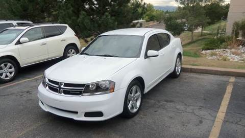2011 Dodge Avenger for sale at QUEST MOTORS in Englewood CO