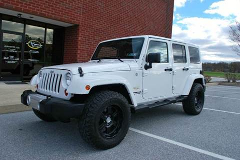 2012 Jeep Wrangler Unlimited for sale at AllVette LLC in Stuart FL