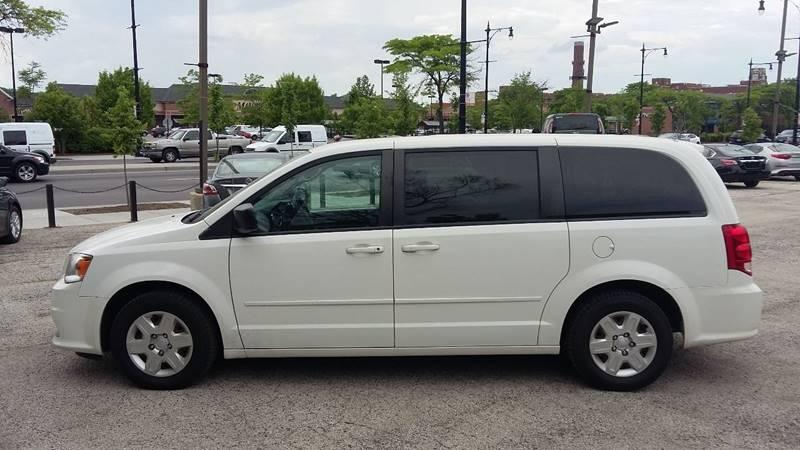 2014 Dodge Caravan for sale at ECONOMY AUTO MART in Chicago IL