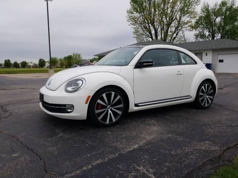 2012 Volkswagen Beetle for sale at CALDERONE CAR & TRUCK in Whiteland IN