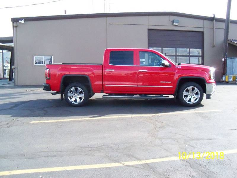 2017 GMC SIERRA 1500 SLT 4X4 4DR CREW CAB 58 FT SB red wow if you dont need a kitchen sink or