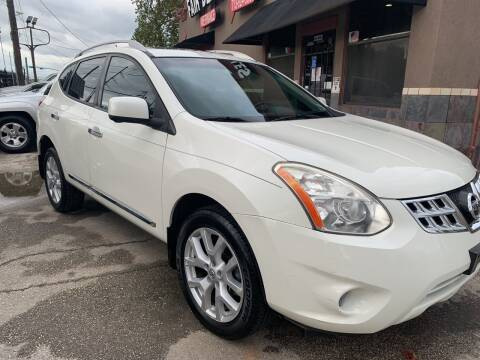 2013 Nissan Rogue for sale at FAIR DEAL AUTO SALES INC in Houston TX