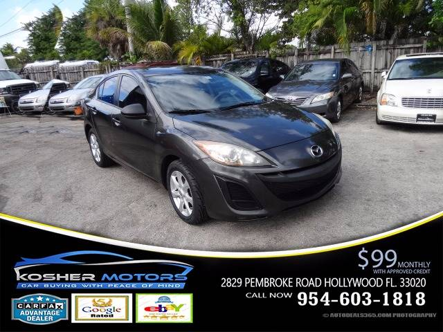 2010 MAZDA MAZDA3 I SPORT 4DR SEDAN 5A gray the 2010 mazda 3 is a premium car in a compact packag