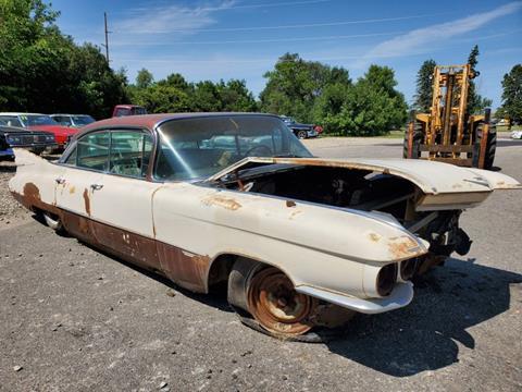 1959 Cadillac DeVille for sale at UNIQUE SPECIALTY & CLASSICS in Mankato MN