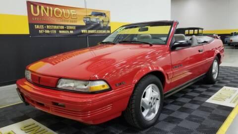1993 Pontiac Sunbird for sale at UNIQUE SPECIALTY & CLASSICS in Mankato MN