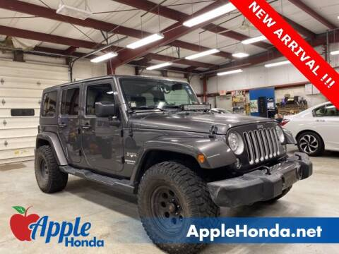 2017 Jeep Wrangler Unlimited for sale at APPLE HONDA in Riverhead NY
