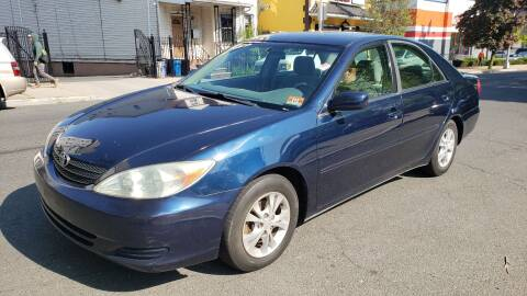2004 Toyota Camry LE for sale at JOANKA AUTO SALES in Newark NJ