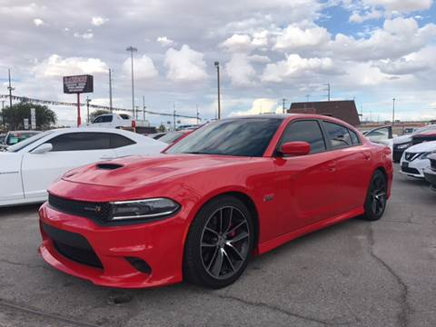 2015 Dodge Charger for sale at Rainbow Motors in El Paso TX