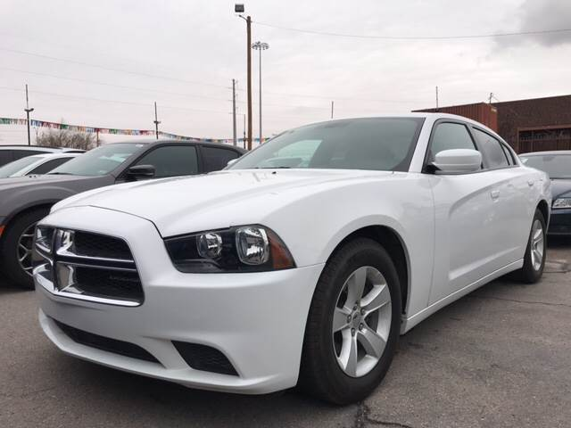 2014 Dodge Charger for sale at Rainbow Motors in El Paso TX