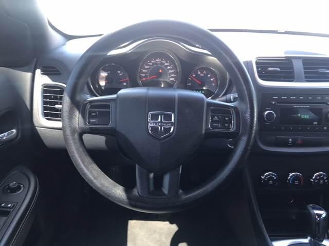 2014 Dodge Avenger for sale at Rainbow Motors in El Paso TX