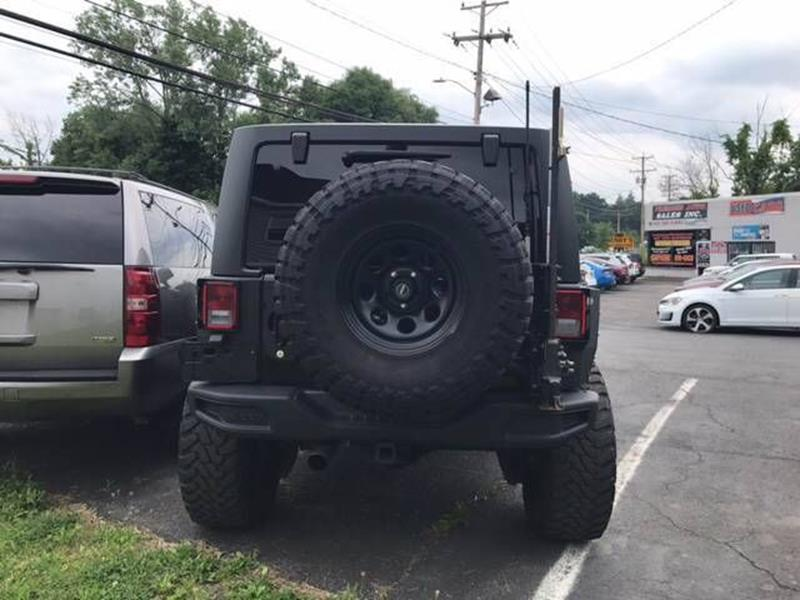 2013 Jeep Wrangler Unlimited for sale at Premier Auto Sales Inc in New Windsor NY