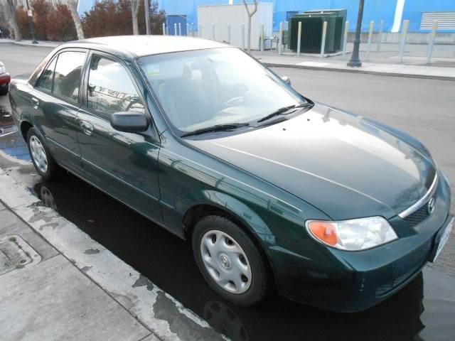 2001 MAZDA PROTEGE LX green amfm radioanti-brake system non-abs  4-wheel absbody style seda