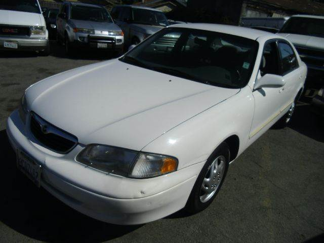 1998 MAZDA 626 LX 4DR SEDAN white 14 inch wheels center console cruise control exterior mirror