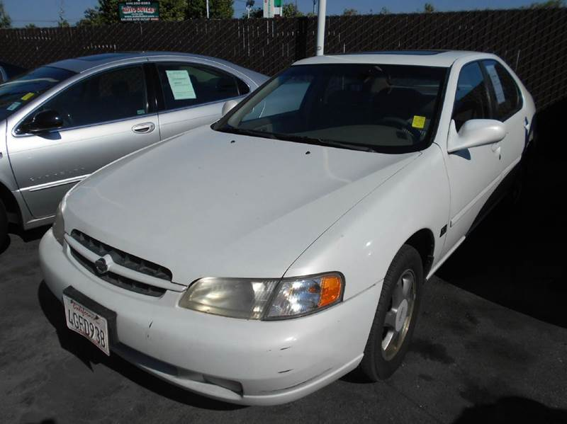 1999 NISSAN ALTIMA GXE 4DR SEDAN white cassette center console cruise control exterior entry l