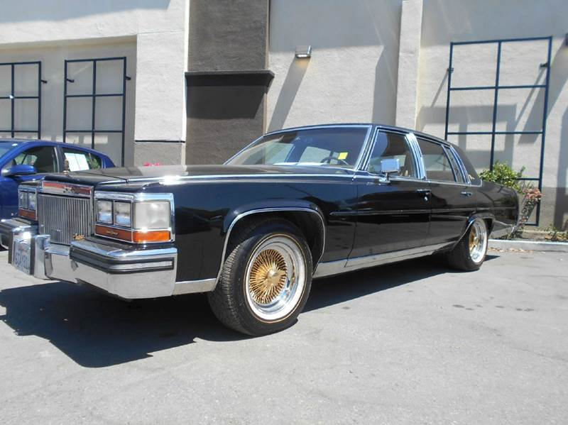 1989 CADILLAC BROUGHAM BASE 4DR SEDAN black antenna type - power clock cruise control driver s
