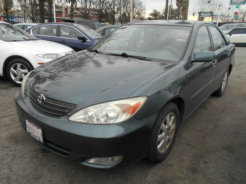 2003 TOYOTA CAMRY LE 4DR SEDAN green cassette center console clock cruise control daytime run