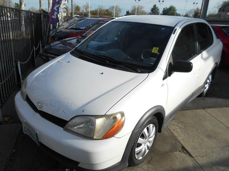 2000 TOYOTA ECHO BASE 4DR SEDAN white center console front airbags - dual front seat type - buc