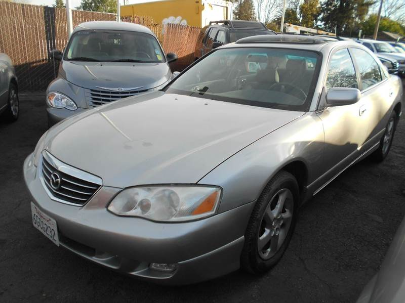 2002 MAZDA MILLENIA PREMIUM 4DR SEDAN silver abs - 4-wheel anti-theft system - alarm center con