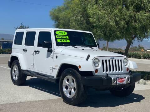 2013 Jeep Wrangler Unlimited for sale at Esquivel Auto Depot in Rialto CA