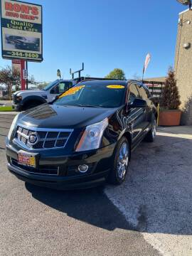 2012 Cadillac SRX for sale at RON'S AUTO SALES INC - MAYWOOD in Maywood IL