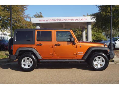 2011 Jeep Wrangler Unlimited for sale at BLACKBURN MOTOR CO in Vicksburg MS