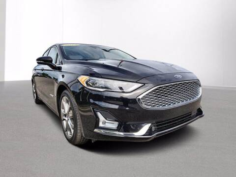 2019 Ford Fusion Hybrid for sale at Jimmys Car Deals in Livonia MI