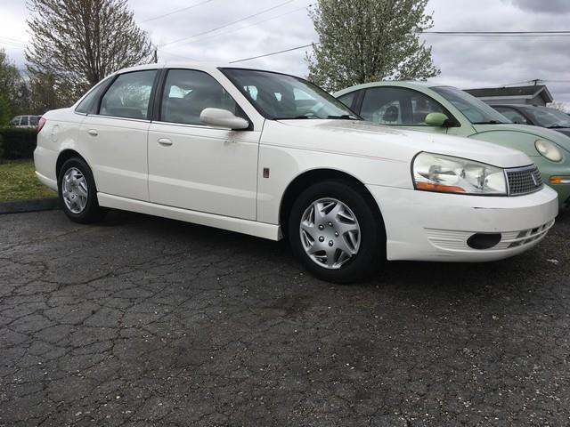 2004 SATURN L300 1 4DR SEDAN white automatic great mpg and low miles air conditioning 4 wheel