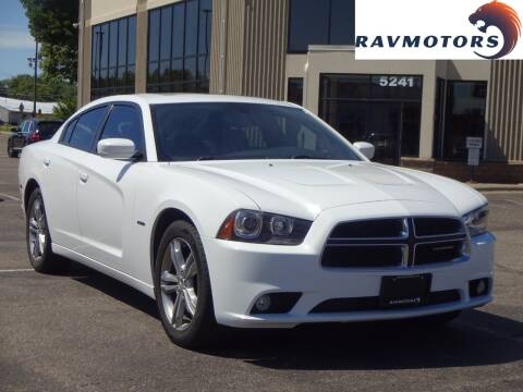 2013 Dodge Charger for sale at RAVMOTORS 2 in Crystal MN