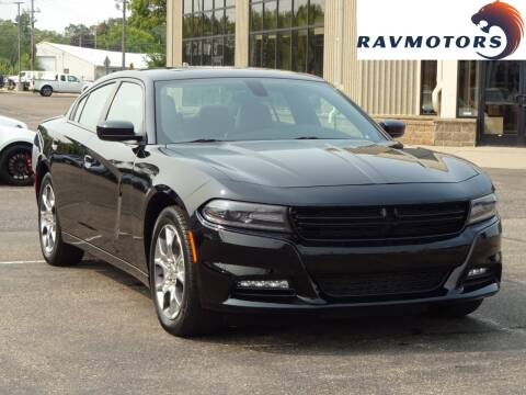 2015 Dodge Charger for sale at RAVMOTORS 2 in Crystal MN