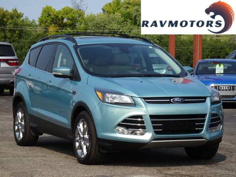 2013 Ford Escape for sale at RAVMOTORS in Burnsville MN