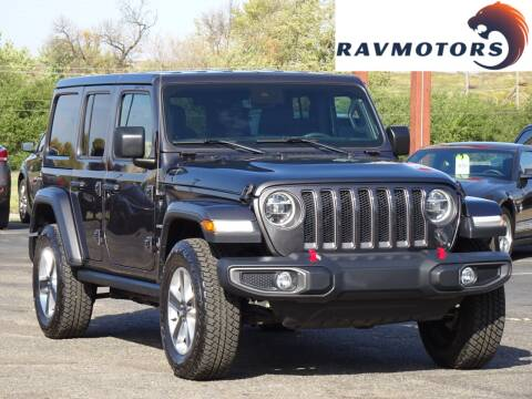 2019 Jeep Wrangler Unlimited for sale at RAVMOTORS in Burnsville MN