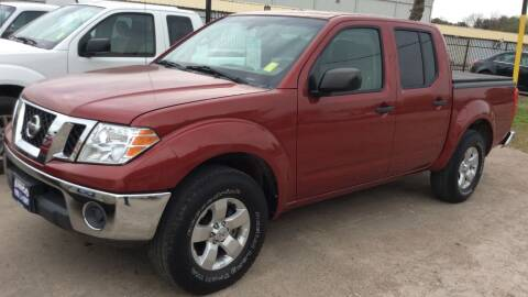 2011 Nissan Frontier for sale at AMIGO USED CARS in Houston TX