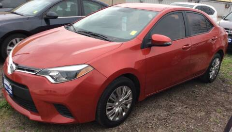 2015 Toyota Corolla for sale at AMIGO USED CARS in Houston TX