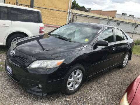 2011 Toyota Camry for sale at AMIGO USED CARS in Houston TX