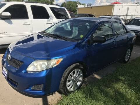 2009 Toyota Corolla for sale at AMIGO USED CARS in Houston TX
