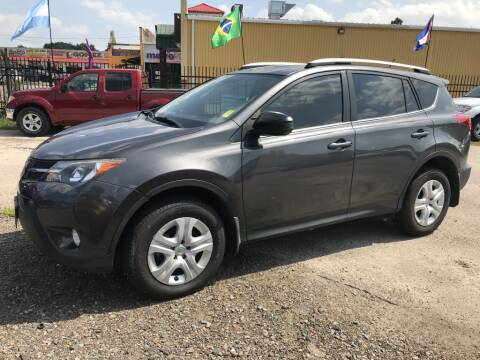 2015 Toyota RAV4 for sale at AMIGO USED CARS in Houston TX