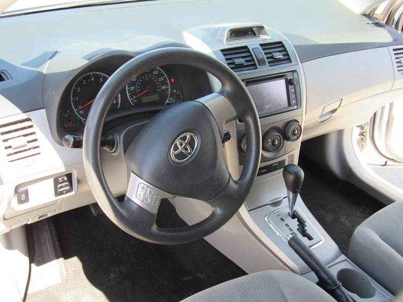 2013 Toyota Corolla for sale at Los Compadres Auto Center in Bloomington CA