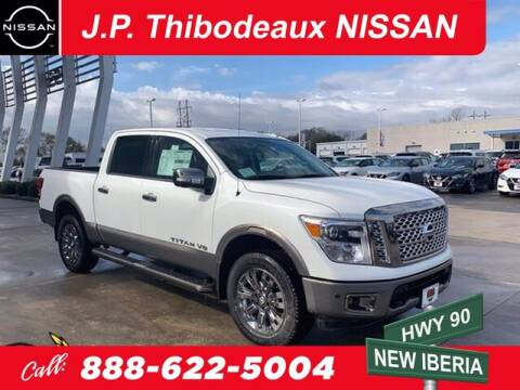 2019 Nissan Titan for sale at J P Thibodeaux Used Cars in New Iberia LA