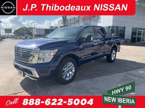 2020 Nissan Titan for sale at J P Thibodeaux Used Cars in New Iberia LA